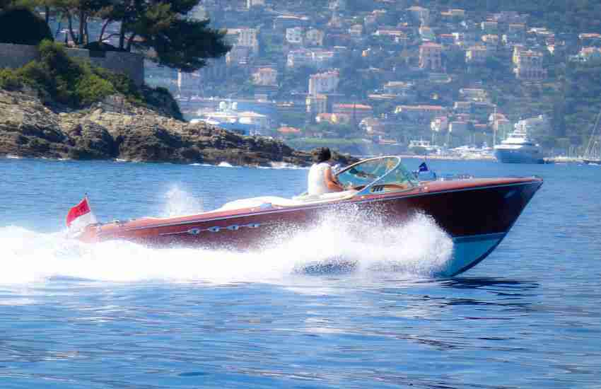 Riva displaying a Monaco flag